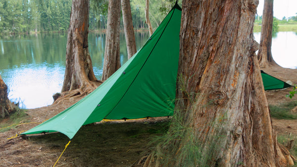 Apex Campgin Shelter set up in Cave Mode by tying a guy line to a tree.
