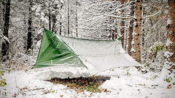 The optional Tarp Door Kit comes with 2 sets of doors that can help block wind and rain as well as provide privacy at both ends of the tarp.