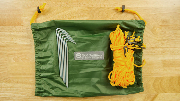 The Apex Camping Shelter 2.0 includes six stakes, two 15' guy ropes with tensioners, six 8' guy ropes with tensioners, a storage bag for the stakes and ropes  and a water resistant Rapid Deployment Bag.