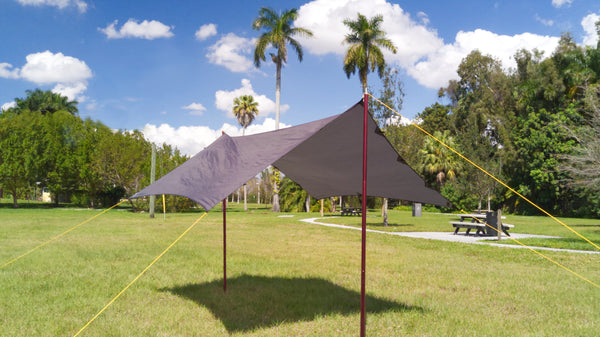 Use tarp poles or attache it to two trees to create a freestanding shade canopy or rain shelter. The hammock tarp can be used a general camping tarp too.