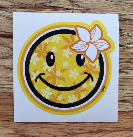 happy face with yellow floral pattern and flower decal