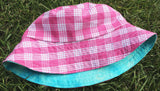 reversible pink palaka and blue tie dye bucket hat