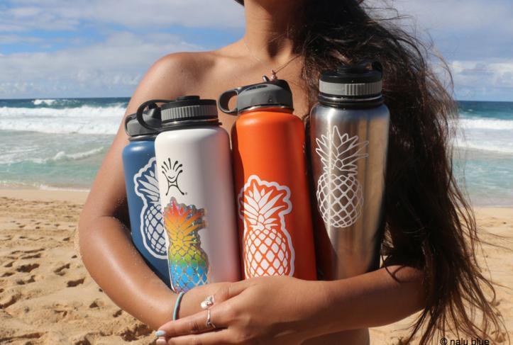 hydroflasks with pineapple stickers