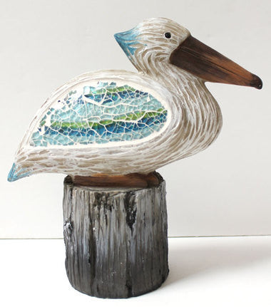 Mosaic Pelican on Piling