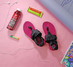 Pink sling sandal with grey straps on a pink background.