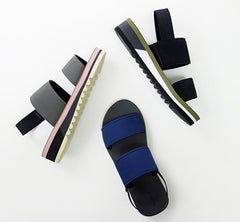 Studio shot of three flatform sandals in different colors and posed at different angles.