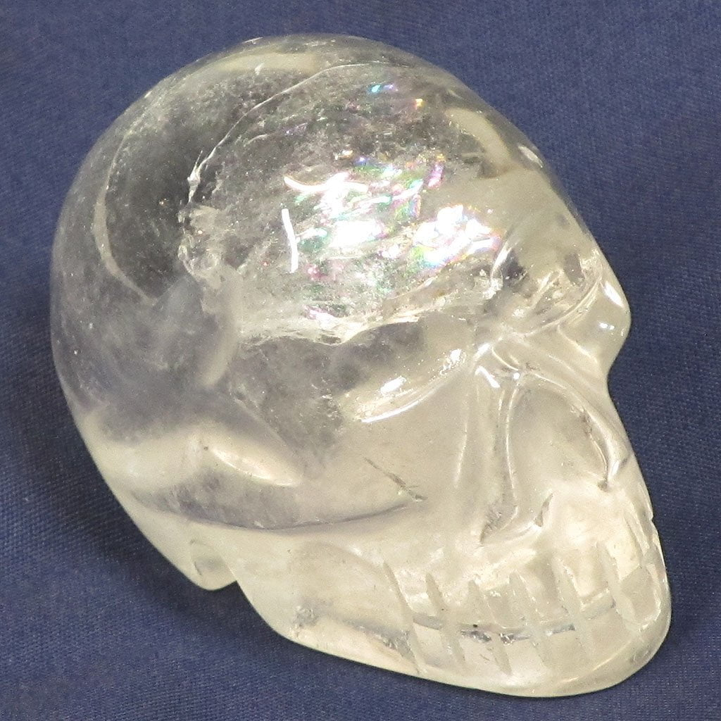 Carved Clear Quartz Crystal Skull with a Rainbow