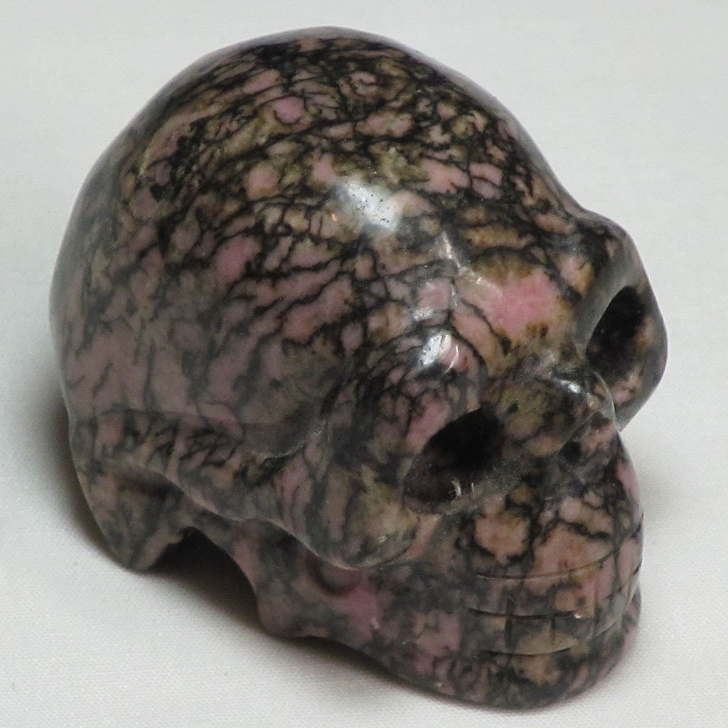 Hand Carved Rhodonite Skull | Blue Moon Crystals & Jewelry