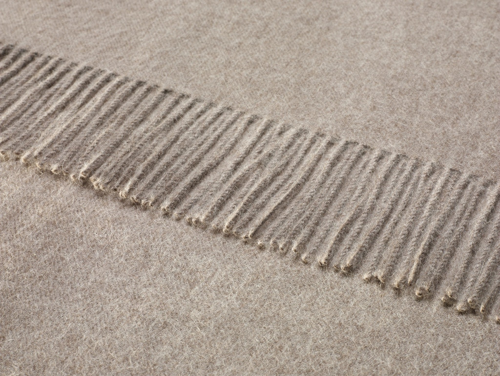 plain light brown throw blanket made from alpaca by bronte moon