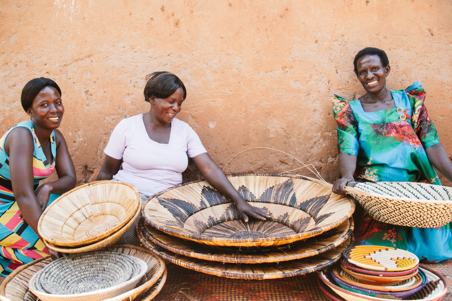 African basket weavers with their work