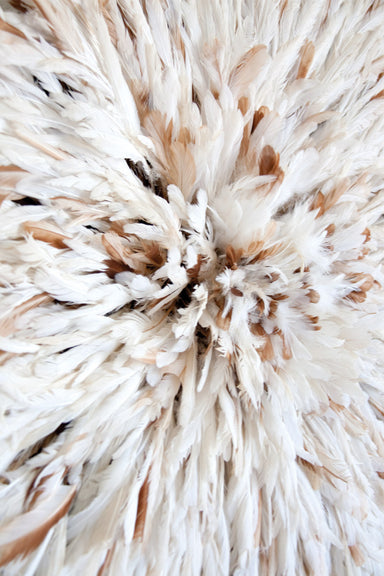Close up view of the feathers inside a White and Tan speckled Authentic African juju hat