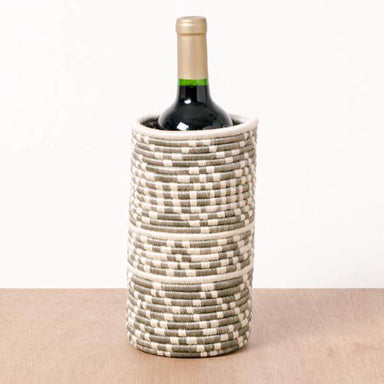 Hand woven tan and white wine holder made in Rwanda by fair trade artisans