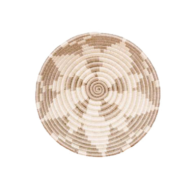 Small tan and white woven basket made in Rwanda for organizing