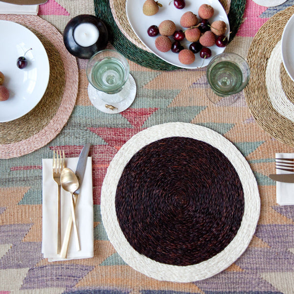 Styled shot of our chocolate brown circle placemat with cream trim in a dining room