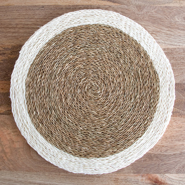 Gone Rural Swaziland hand woven circle placemat in natural tan with white trim