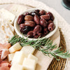 Charcuterie with olives in a soapstone bowl