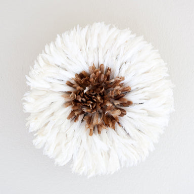 Small white African feather headdress with tan center