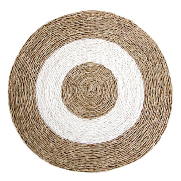 Hand woven circle placemat in natural tan with white circles inside