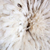 detail shots in the authentic African juju hat in a warm, creamy white color