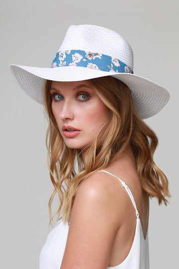 Panama Hat with Floral Detail This white panama hat has beautiful blue floral band details and will protect your face poolside and beachside in style.  22