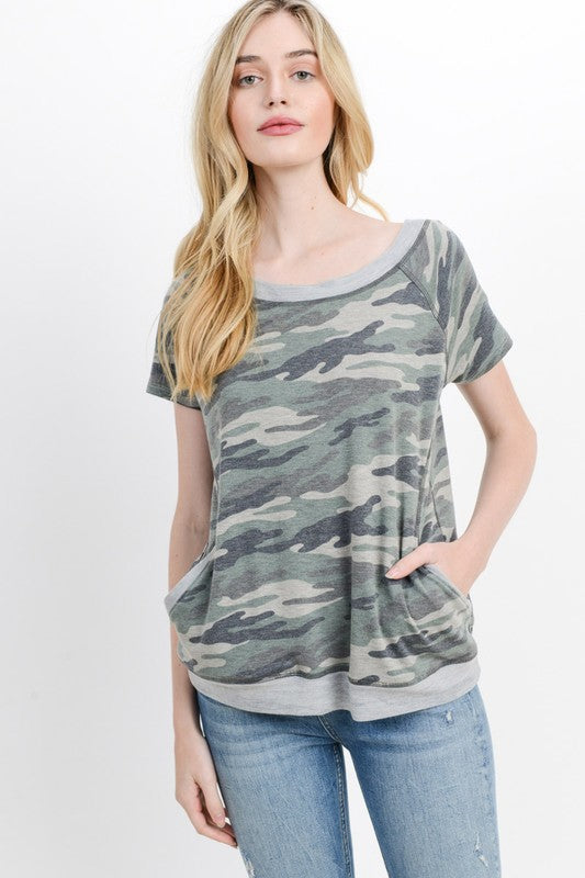 This soft off/on shoulder camo printed pullover has an easy fit with a banded hem. Cute scoop neck. Poly/Rayon/Span. Model is 5'9