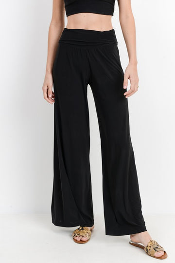 These super soft fold over palazzo pants are a medium, non sheer venecchia knit fabric that drapes beautifully and has awesome stretch. These are incredibly versatile! Can be worn to work or play and even thrown on with your favorite swimsuit as a cover up. Poly/Span. Model is approx 5'9