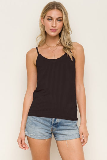 Better Than Basic Black Tank Love a classic black tank top but want a little interest to feel a little more special? Then this tank is for you! Lettuce trim top and adjustable straps make this flattering vertical ribbed tank top a winner. Cotton/Span. Model is 5'9.5