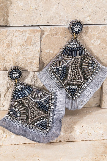 These gorgeous glass and seed bead earrings have a versatile gray color you can pair with so much in your closet! Approx 3