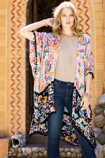 This lightweight floral duo color print cardigan has pom pom tassel details and is Approx 39.5x74.5 with 1