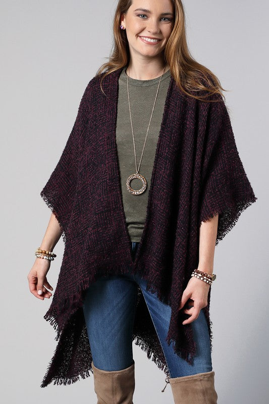 Open Cardi Style in Stunning Plum Weave This fall fabulous basket weave Ruana wrap pairs perfectly with a tee and jeans for an effortlessly cool fall look. Just a little extra warmth for those cool fall days! Acrylic. One size fits most.  Tacked Sleeves Frayed Edges Basket Weave Pattern  34x43.5