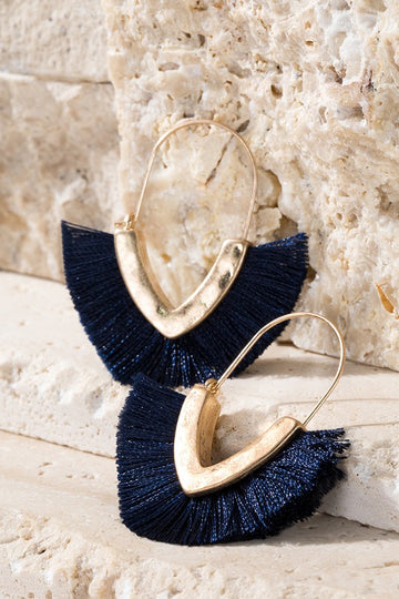 This hammered gold tone earring has a V shape and navy fringe details. Approx 2