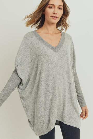 The Ultimate Fall/Winter Casual Top For that everyday effortless style you crave throw on this soft brushed v neck tunic top with your skinny jeans or Fleece Lined Leggings for ultimate comfort & style. Rayon/Poly/Span. Model is 5'9