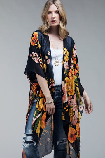 Poppy Print Gray Kimono Cardigan This stunning kimono cardigan will be a summer style go to for adding a little wow to to your jeans and shorts styles! Modal/Viscose. Model is 5'9
