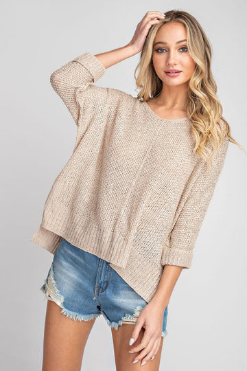 Our lightweight oatmeal sweater is one you can wear all the way into summer! A simple but chic crew neck that is comfy and cute! Model is a size 2 and 5'8