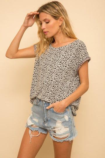 Cool Embroidered Sleeve Leopard Top This leopard print top is a little bit extra special with the intricate and beautiful detailing on the short sleeves! Throw this one with your favorite jeans and shorts for a super effortlessly cute style. Loose fit and easy to wear! Poly/Span Model is 5'8