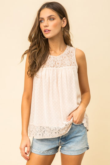 Beautiful Light Apricot Lace Top Feel light and airy with this lovely lace contrast top. Pair with jeans or shorts for a romantic and feminine look you will love to wear all summer long! Polka dot and Lace details in this cutie! Poly/Nylon/Cotton/Rayon. Model is 5'9