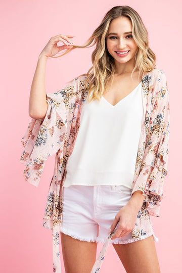 Fabulously feminine floral kimono with gorgeous ruffle flare sleeves and a flattering tie waist detail to show your shape if you want. Throw it on over your everyday style to up your spring and summer looks. Poly. Model is 5'8