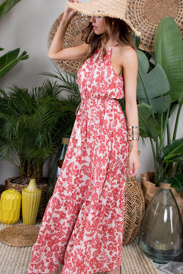 Halter Maxi Love! This beautiful feminine cranberry floral halter maxi dress has a lovely fresh style and fit. Ruffle hem and tie details around neck and waist for creating the best fit for you! Poly. Model is 5'9