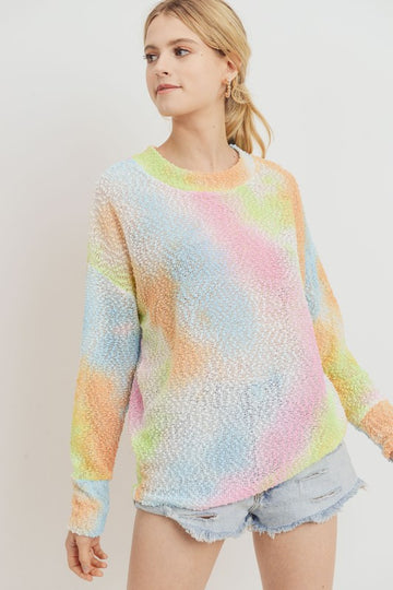 This lightweight popcorn knit sweater has a colorful tie dye pattern in this season's hottest neon colors. Pairs perfectly over your shorts for a little warmth on cool spring mornings and chilly summer nights. Relaxed fit. Poly. Model is 5'9