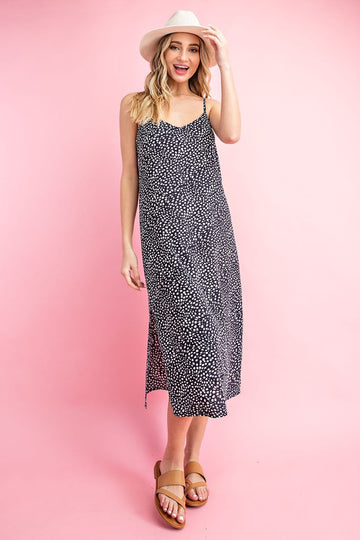 Our sleek and chic slip dress has a dot pattern with adjustable straps. We love the side slit to give this dress movement and to give you more shape with a slip dress. Model is size 2, 5'8