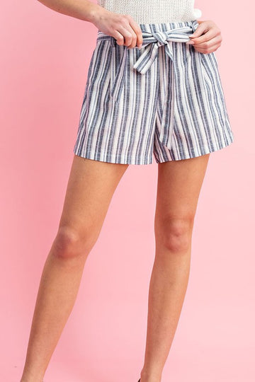 Loving these Striped Bow Shorts! These relaxed fit shorts have a flattering vertical stripe and self tie bow front. High waisted fit. Cotton/Linen/Poly  Bow Tie Waist Vertical Stipes Easy Fit These Striped Bow Shorts ship in 1-2 weeks.