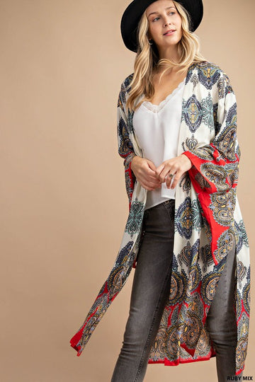 Colorful Paisley Cardigan Style You will turn heads with this bright and beautiful paisley kimono cardigan that pairs great with your favorite tee and jeans. Rayon. Model is approx 5'8