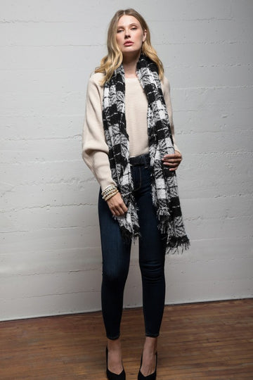Gift Worthy. Or Get it for you! Get in the winter spirit with this beautiful and oversized white and black buffalo scarf. This black and white combo pairs great with everyday casual style. Poly. One size. Final sale.  Approx 72.5x26.5  Brushed Fabric Biased Fringe Bottom This Black & White Plaid Oversized Scarf ships FREE 1-2 weeks.  being yourself is the key!