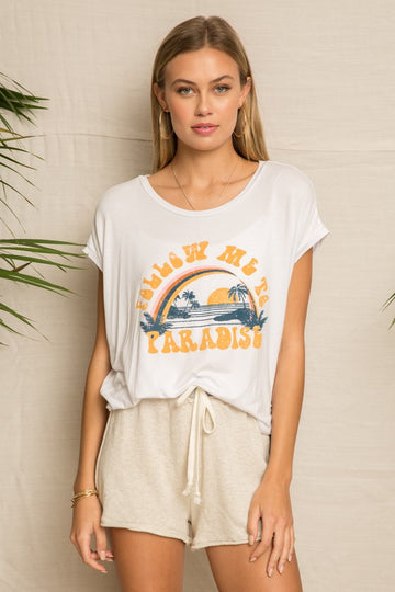 Paradise Graphic Tee Cool and comfy is how we love a graphic tee that you can throw on with your lounge pants, your jeans or shorts. Take this virtual trip to paradise in comfort! Rayon/Span Model is 5'8