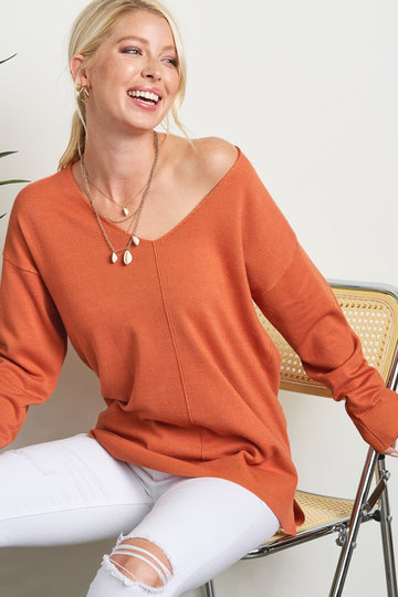 V Neck Ginger Sweater A transitional super soft sweater that will look and feel great with white or blue denim! Relaxed fit. Viscose, Nylon, Poly. Model is 5'9