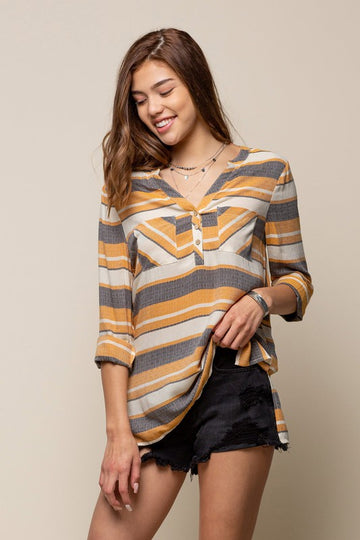 Versatile Mustard Striped Top Grab this relaxed fit gray, ivory and mustard striped top. Has double front pockets and side split hem and looks great with jeans or shorts. Rayon. Model is 5'9
