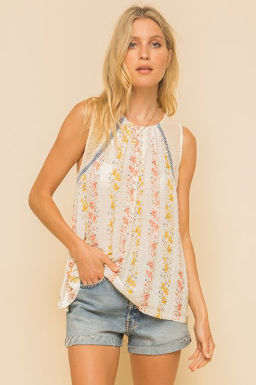 Lovely Detailed Swiss Dot Floral Top So many beautiful details in this floral sleeveless top! Throw this lovely multi media mixed tank top on with your favorite jeans and shorts! Pairs perfectly with all color denim! Rayon/Span/Cotton. Model is 5'8