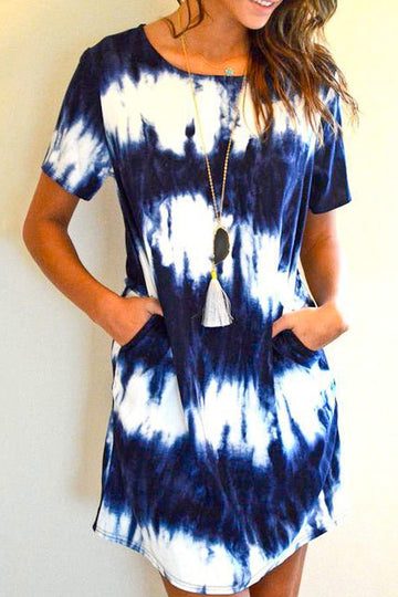 Tie Dye Tee Dress! This soft and comfy Navy Tie Dye Tee Dress is an effortlessly cute look for any day. Relaxed fit. Cotton/Poly. Model is wearing a small.  Has Pockets Relaxed Fit Easy To Wear This Navy Tie Dye Tee Dress ships FREE In 1 wk.   being yourself is the key!