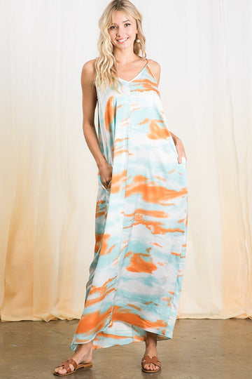 Blue & Orange Tie Dye Maxi From Pool to Patio! Throw this loose fitting pocket maxi on over your swimsuit or for a tropical vibe on your patio. Poly. Model is 5'9