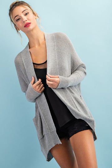 Effortlessly Cute Gray Cardigan Throw this awesome gray cardigan with a tank or tee, shorts or jeans for a year round and super easy to wear look! Acrylic/Poly/Nylon/Viscose Model is 5'8